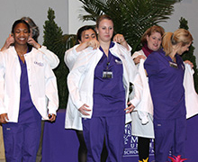 group of students in coats and scrubs