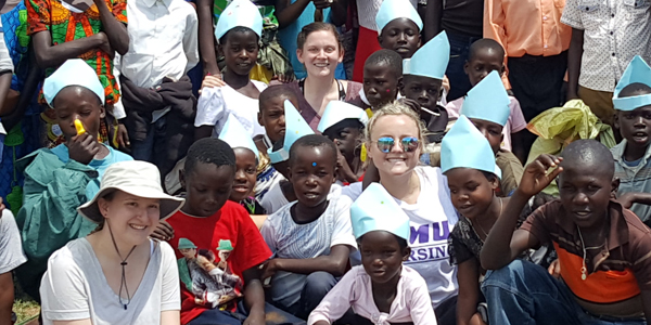 group of students and clinic participants in tanzania