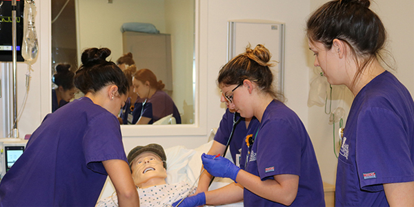 students participating in a patient simulation lab